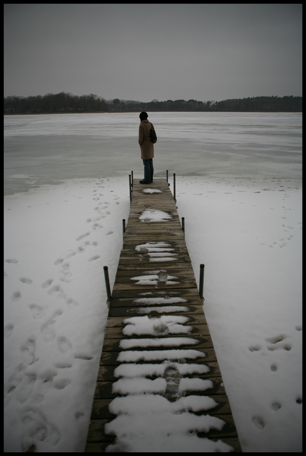 At the end of a long pier on a frozen lake...